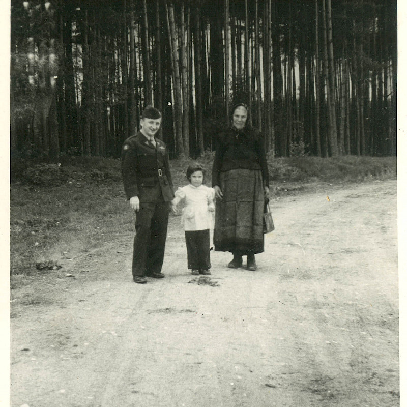 Ben with a local family in a rural area of Bavaria, 1946